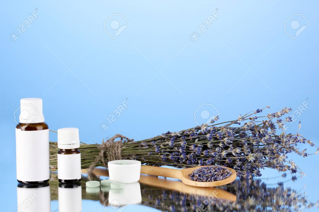 bottles of medicines and herbs on blue background. concept of homeopathy Stock Photo - 16414123