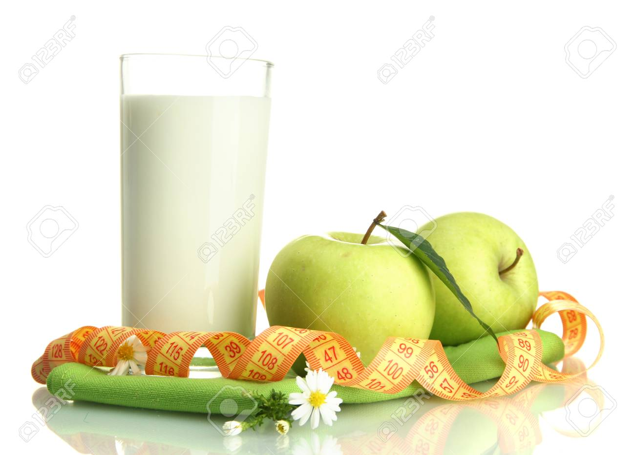 Glass of kefir, green apples and measuring tape isolated on white Stock Photo - 16412271