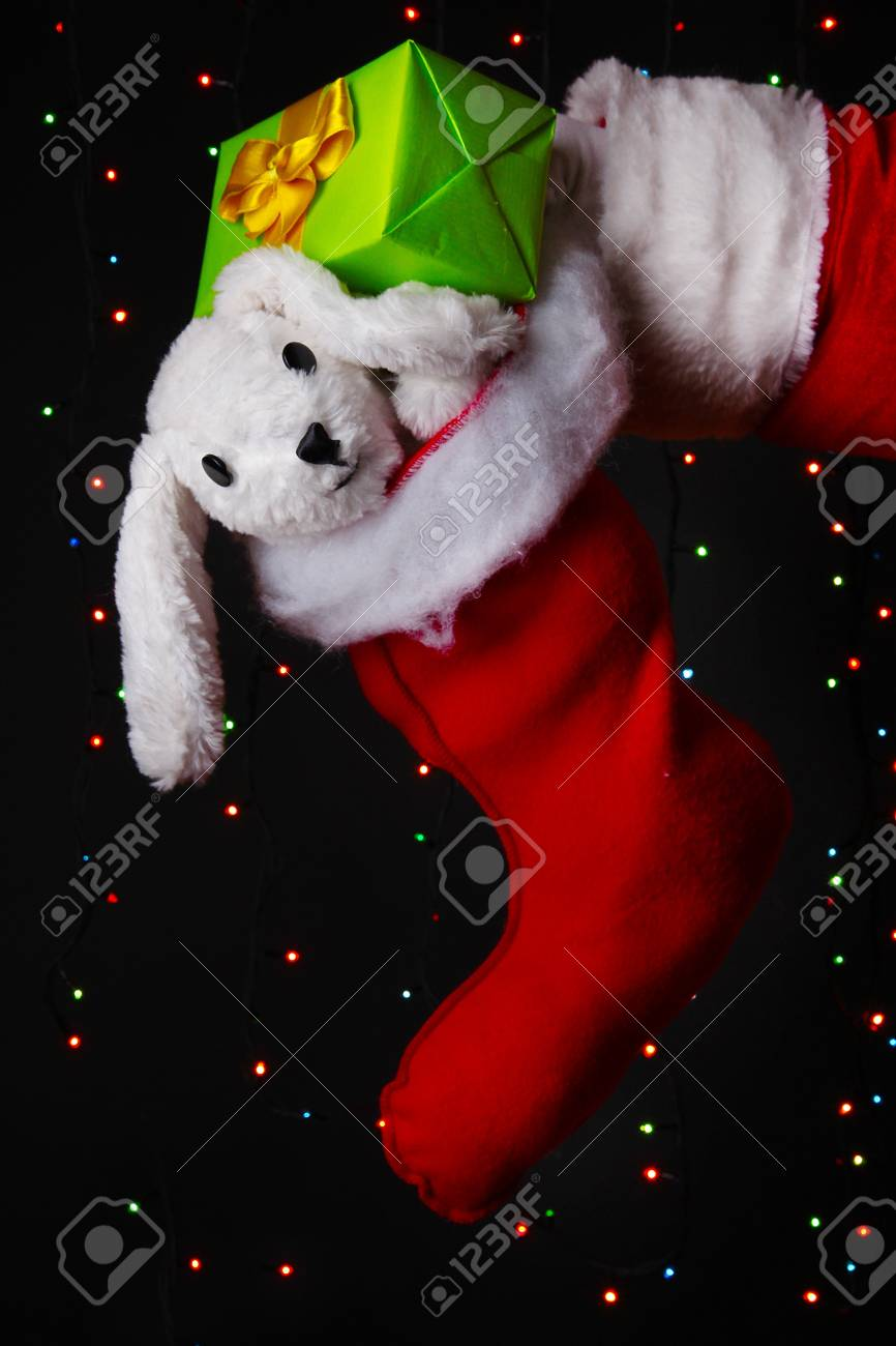 Santa Claus hand holding gifts on bright background Stock Photo - 16495689