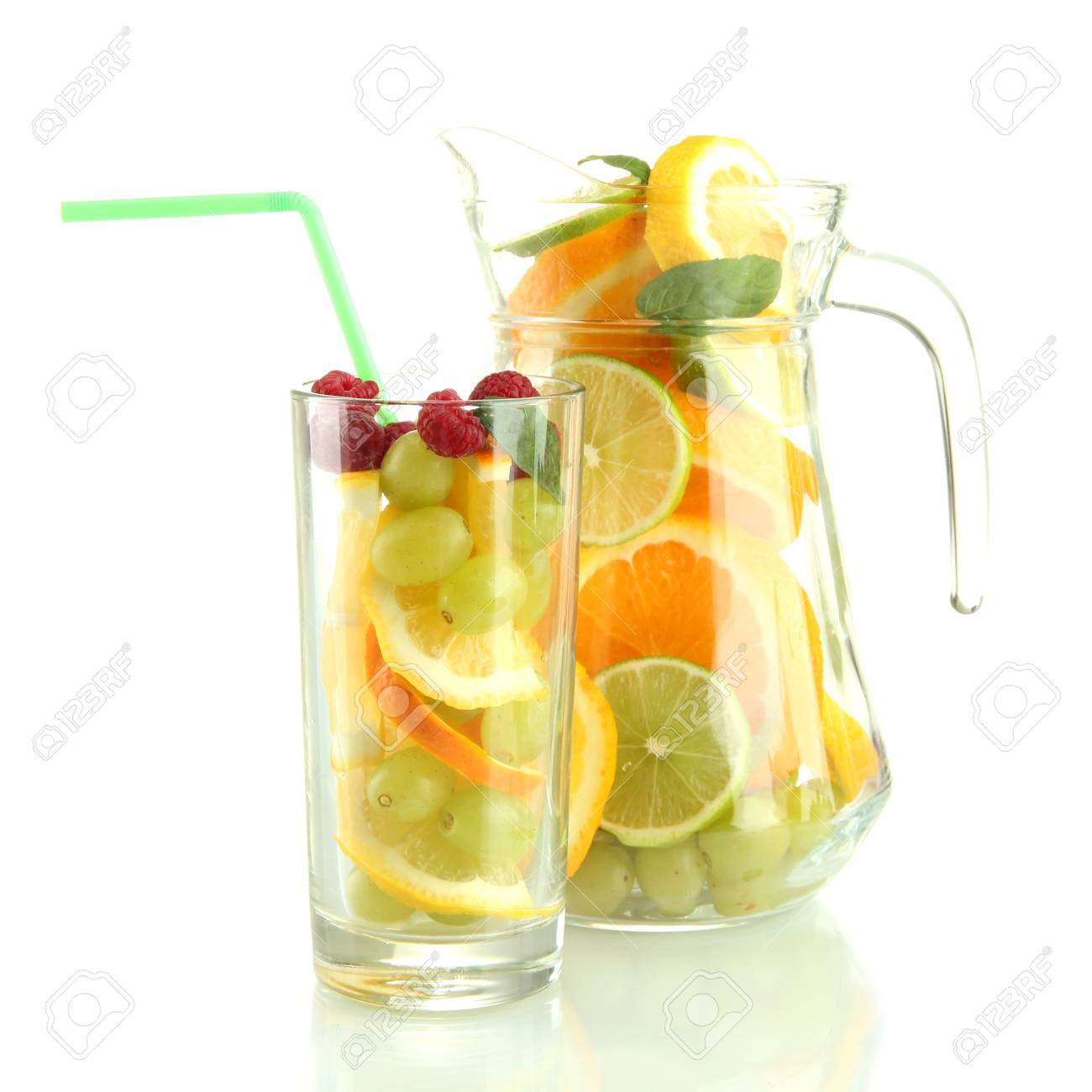 transparent jar and glass with citrus fruits and raspberries, isolated on white Stock Photo - 16591672