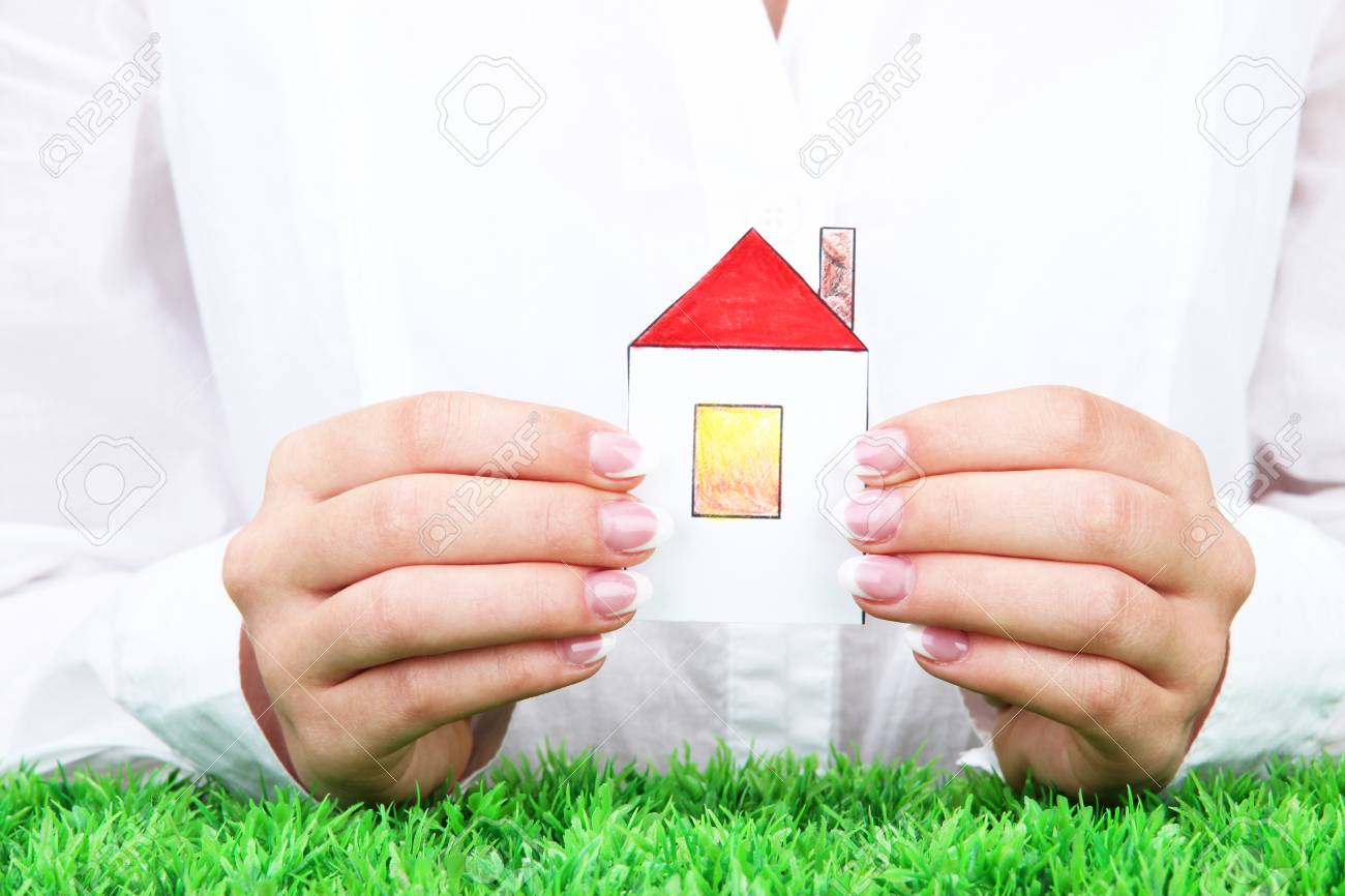 concept: woman hands with paper house, close up Stock Photo - 16592336