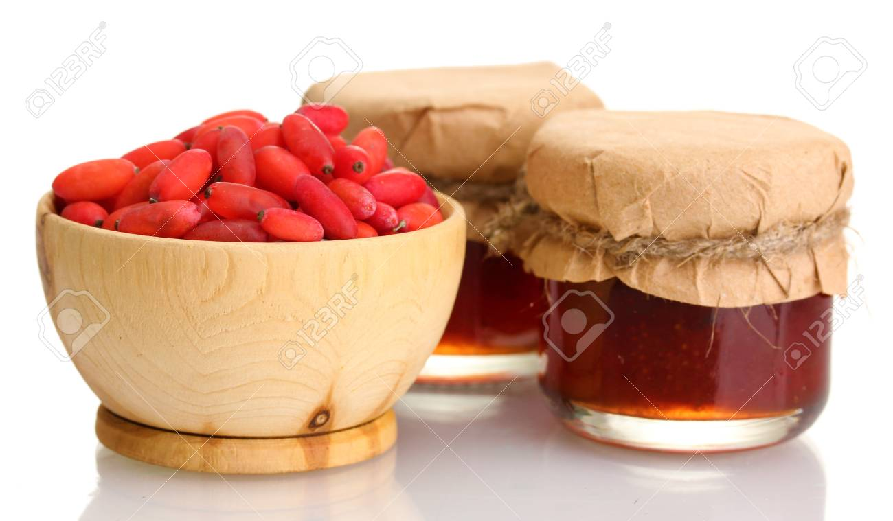 ripe barberries in wooden bowl and jars of jam isolated white Stock Photo - 16620137