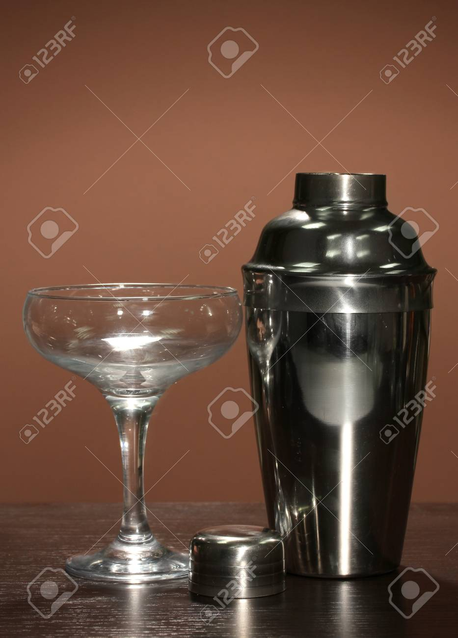 Cocktail shaker and cocktail glass on color background Stock Photo - 16738412
