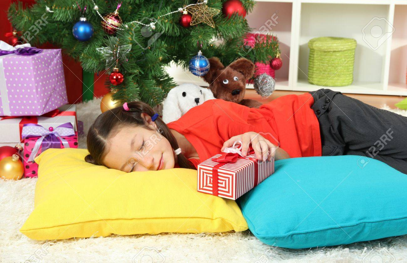 Little girl sleeping near christmas tree Stock Photo - 17129961