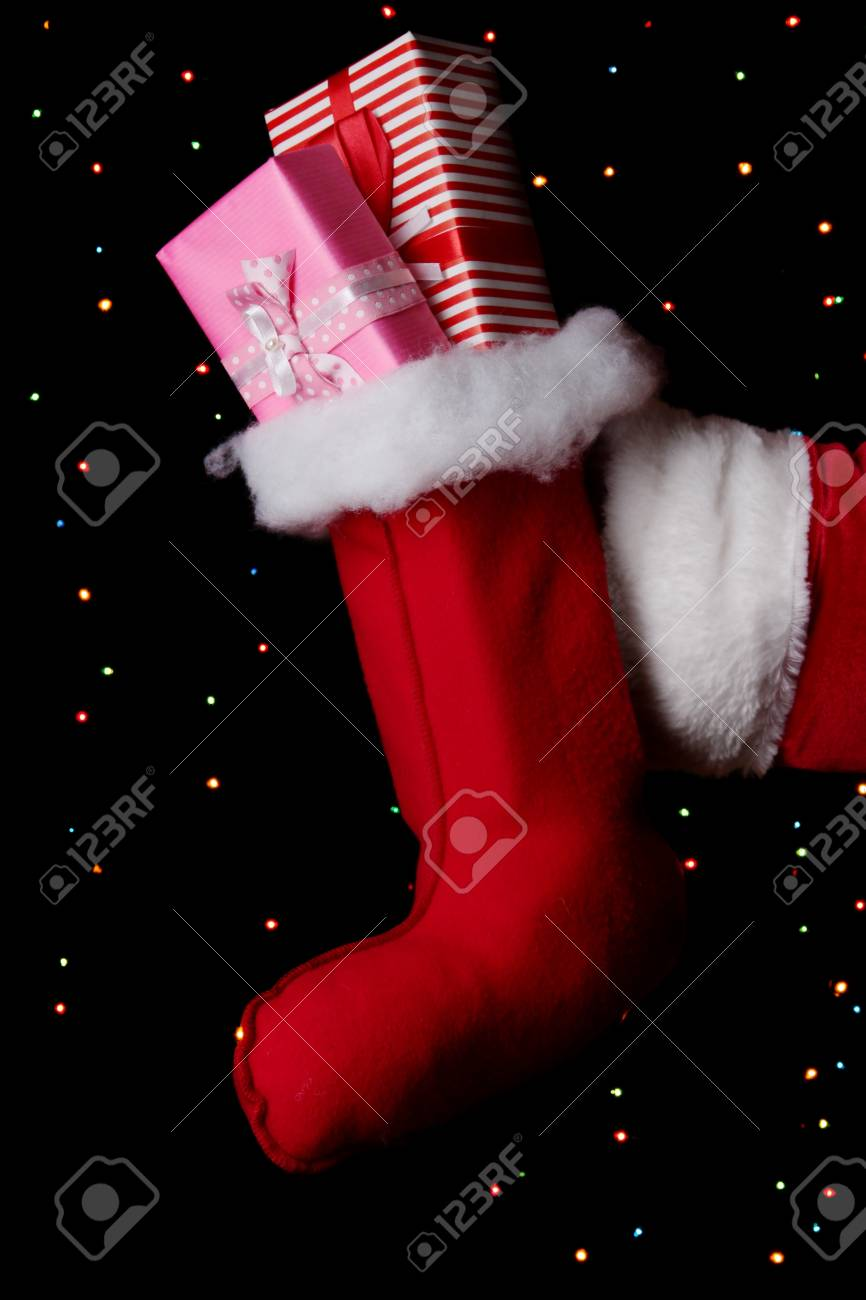 Santa Claus hand holding gifts on bright background Stock Photo - 16738075
