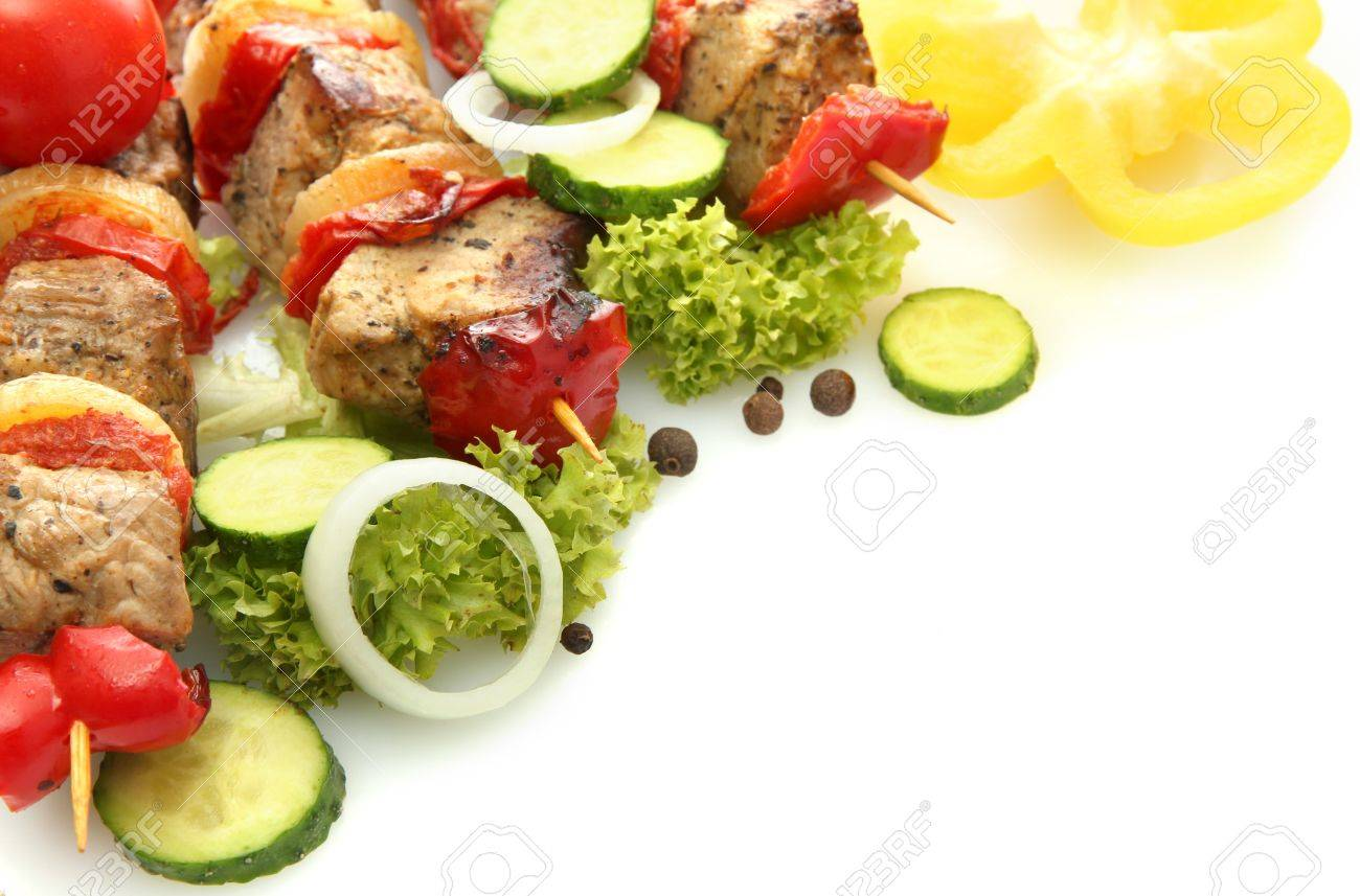 tasty grilled meat and vegetables on skewers, isolated on white Stock Photo - 16788111
