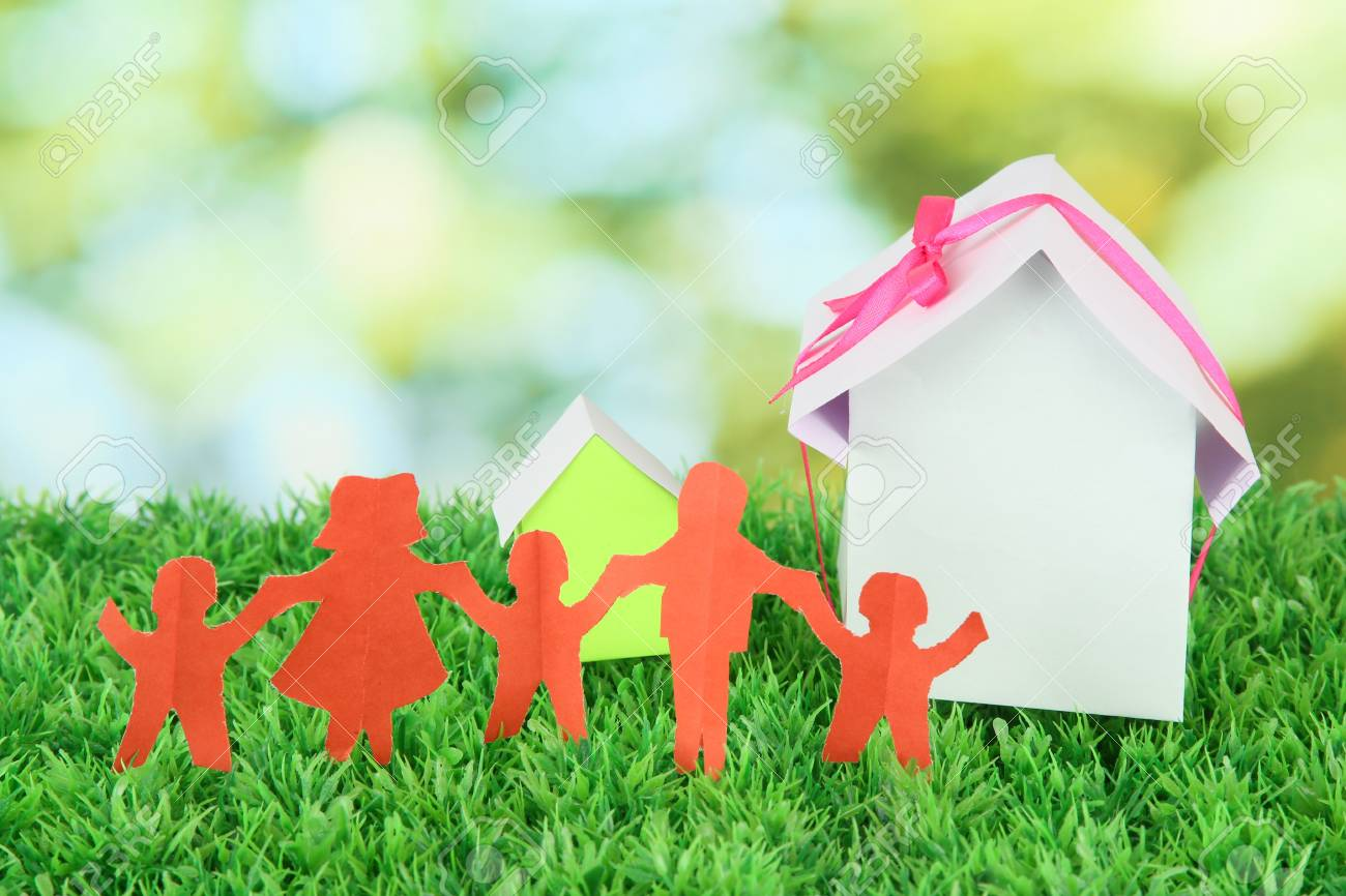 Paper people on green grass on bright background Stock Photo - 16805361