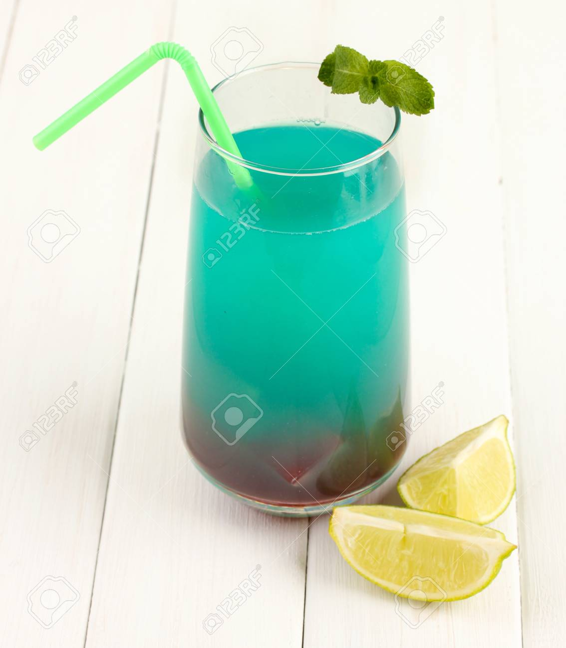Glass of multicolor cocktail on white background Stock Photo - 16937951