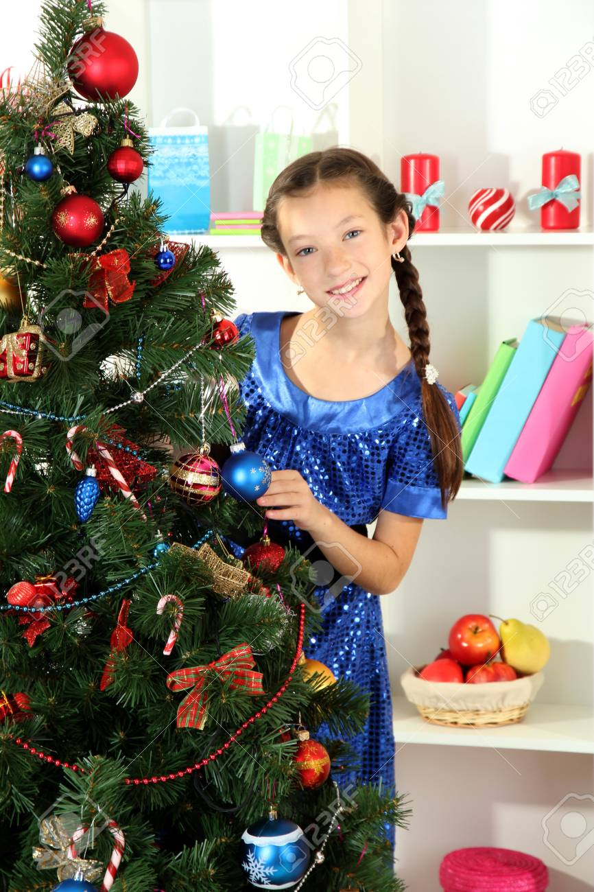 Little girl decorating christmas tree Stock Photo - 17186447
