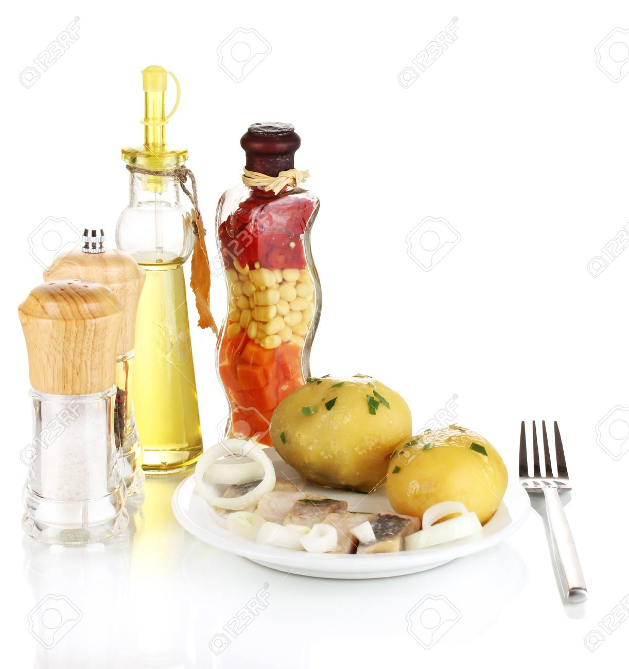 Dish of herring and potatoes on plate isolated on white Stock Photo - 17110358