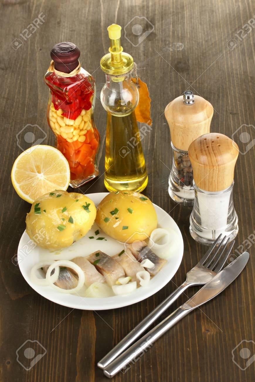 Dish of herring and spices on wooden table close-up Stock Photo - 17138279