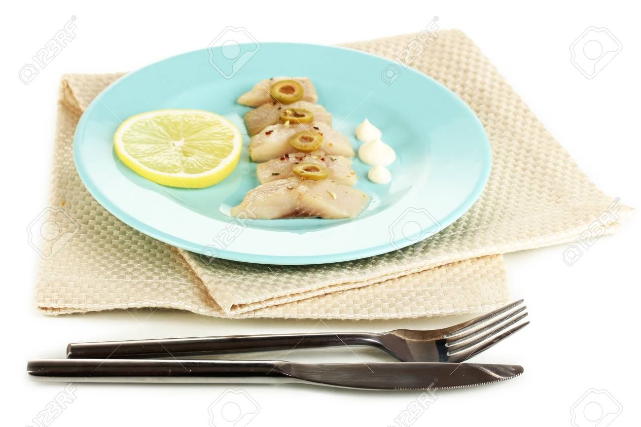 Dish of herring and lemon on plate isolated on white Stock Photo - 17187965
