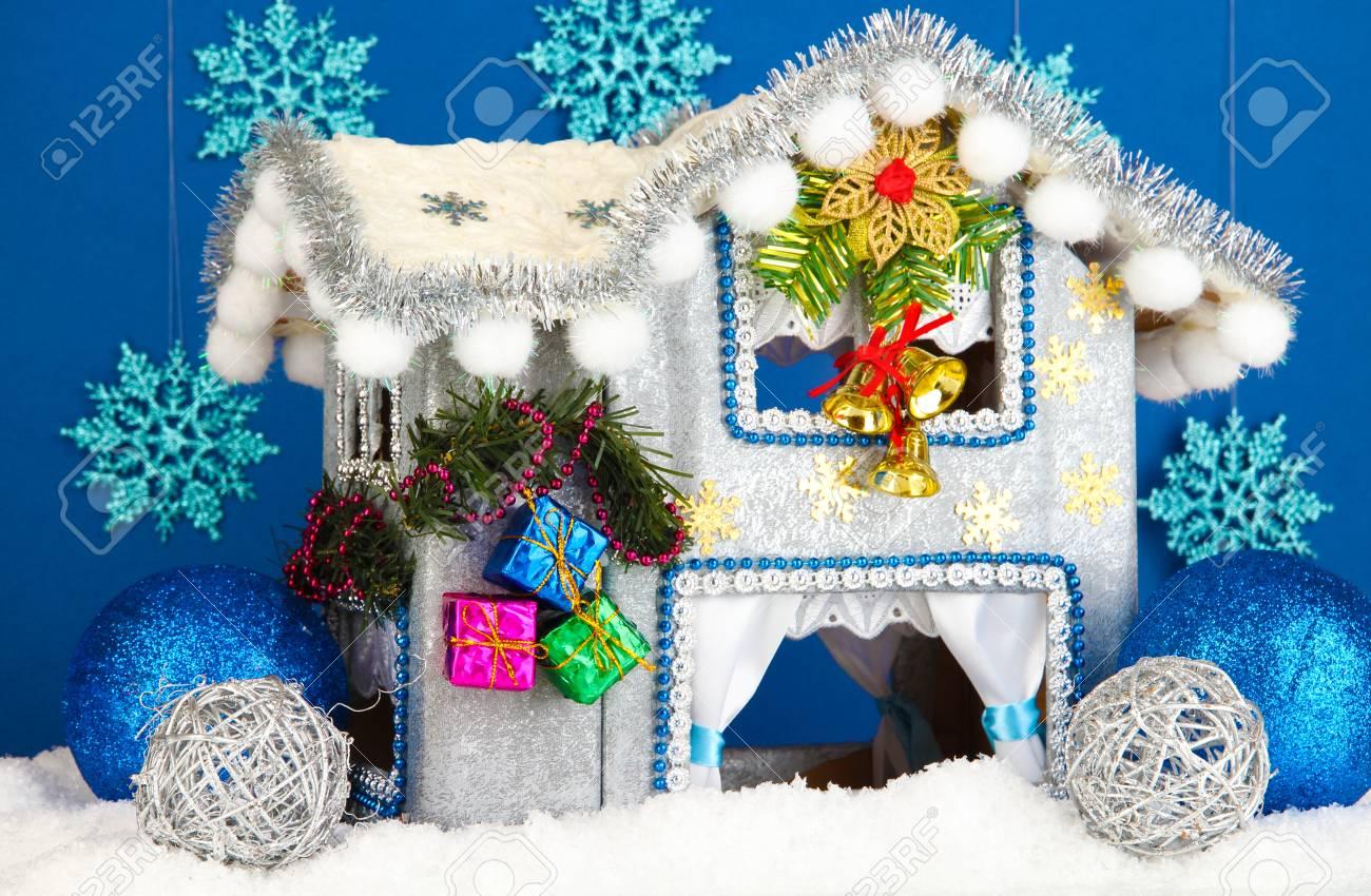 Decorated Christmas house on blue background Stock Photo - 17265904