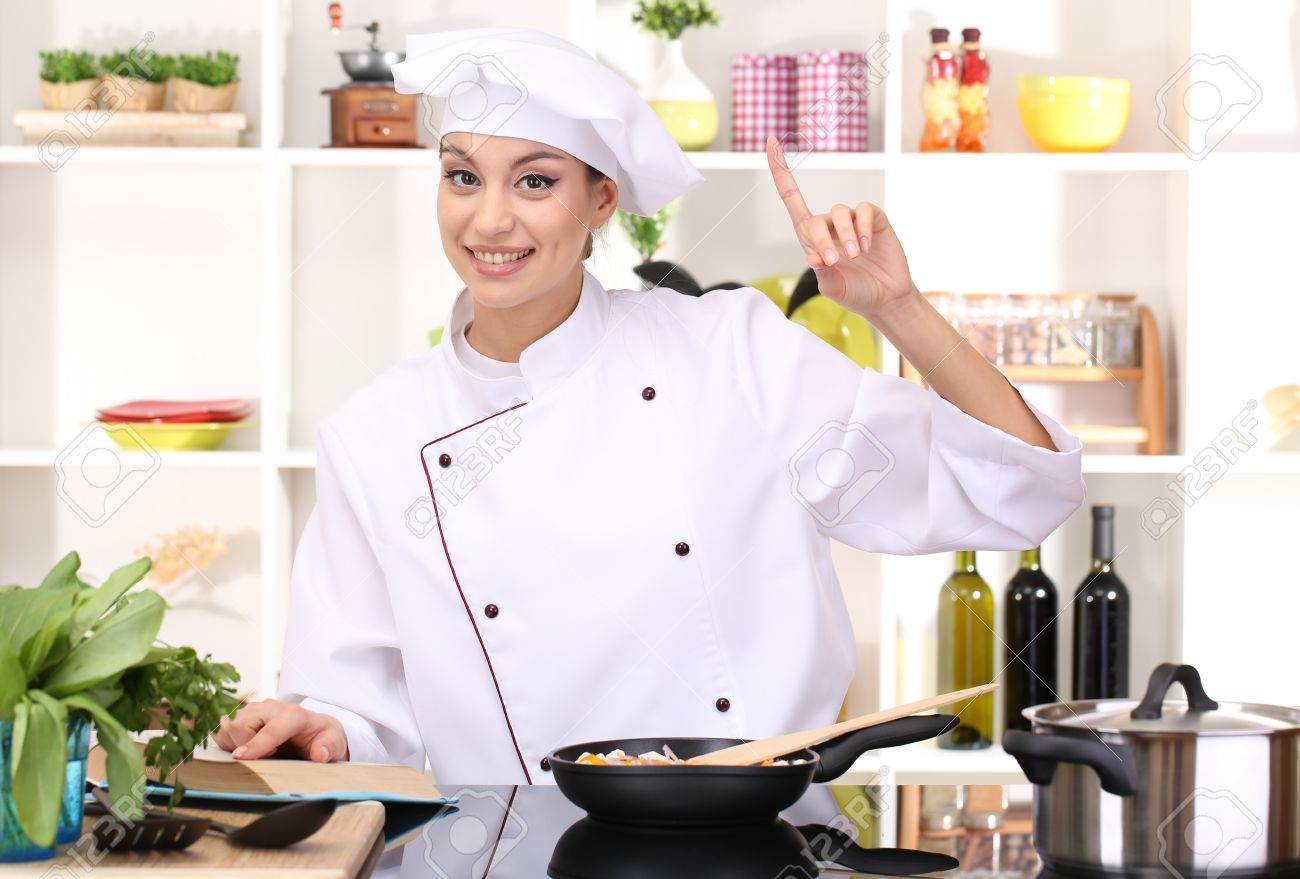 young woman chef cooking in kitchen stock photo picture and royalty