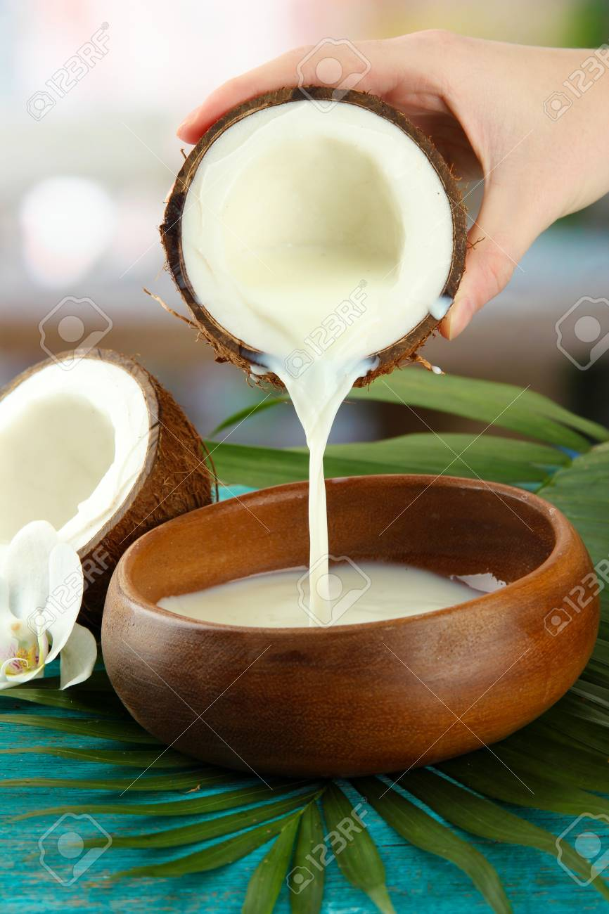 Coconut with leaves and flower, on blue wooden background Stock Photo - 17321659