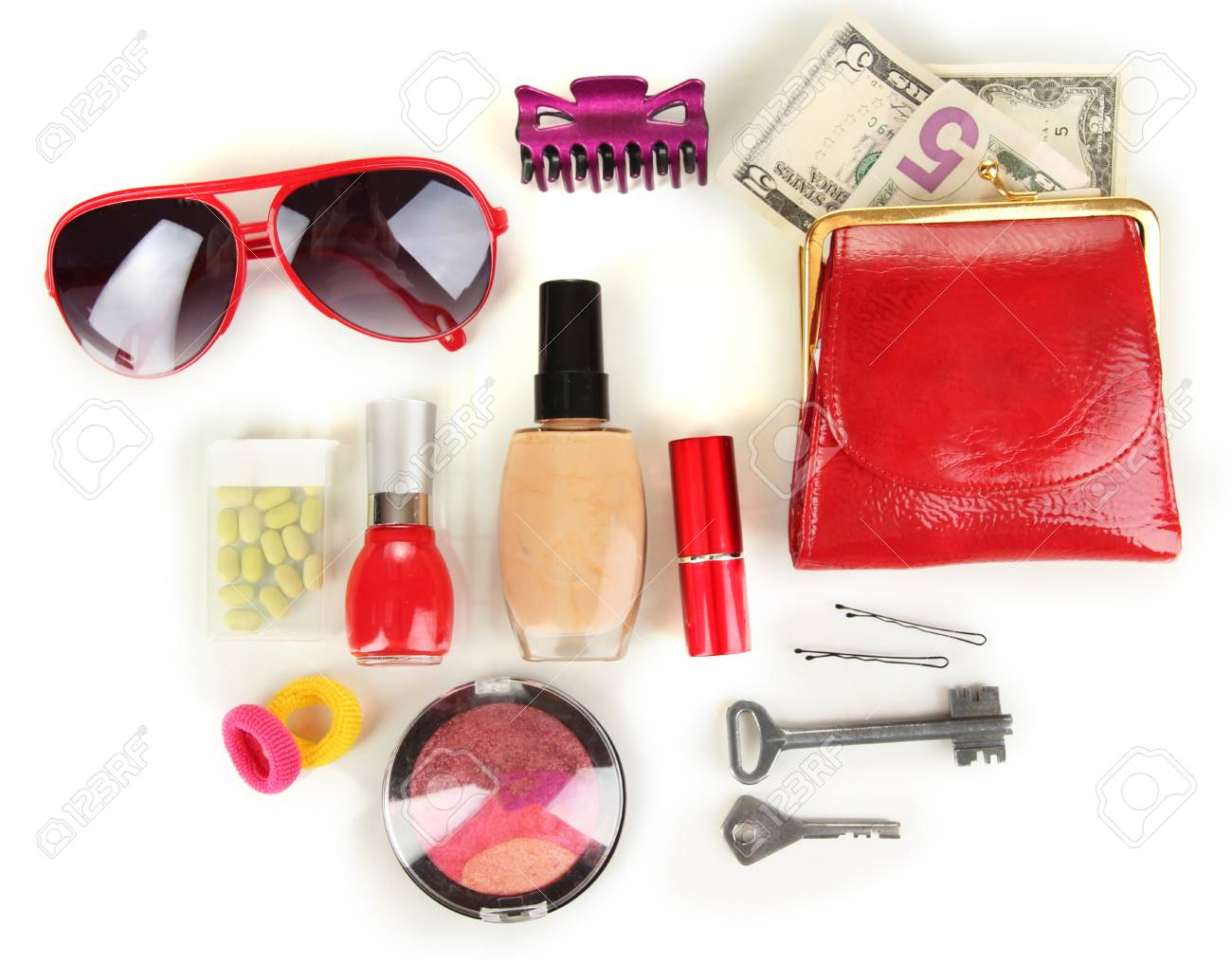 Items contained in the women's handbag isolated on white Stock Photo - 17350451