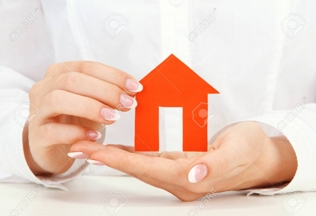 concept: woman hands with paper house, close up Stock Photo - 17399980