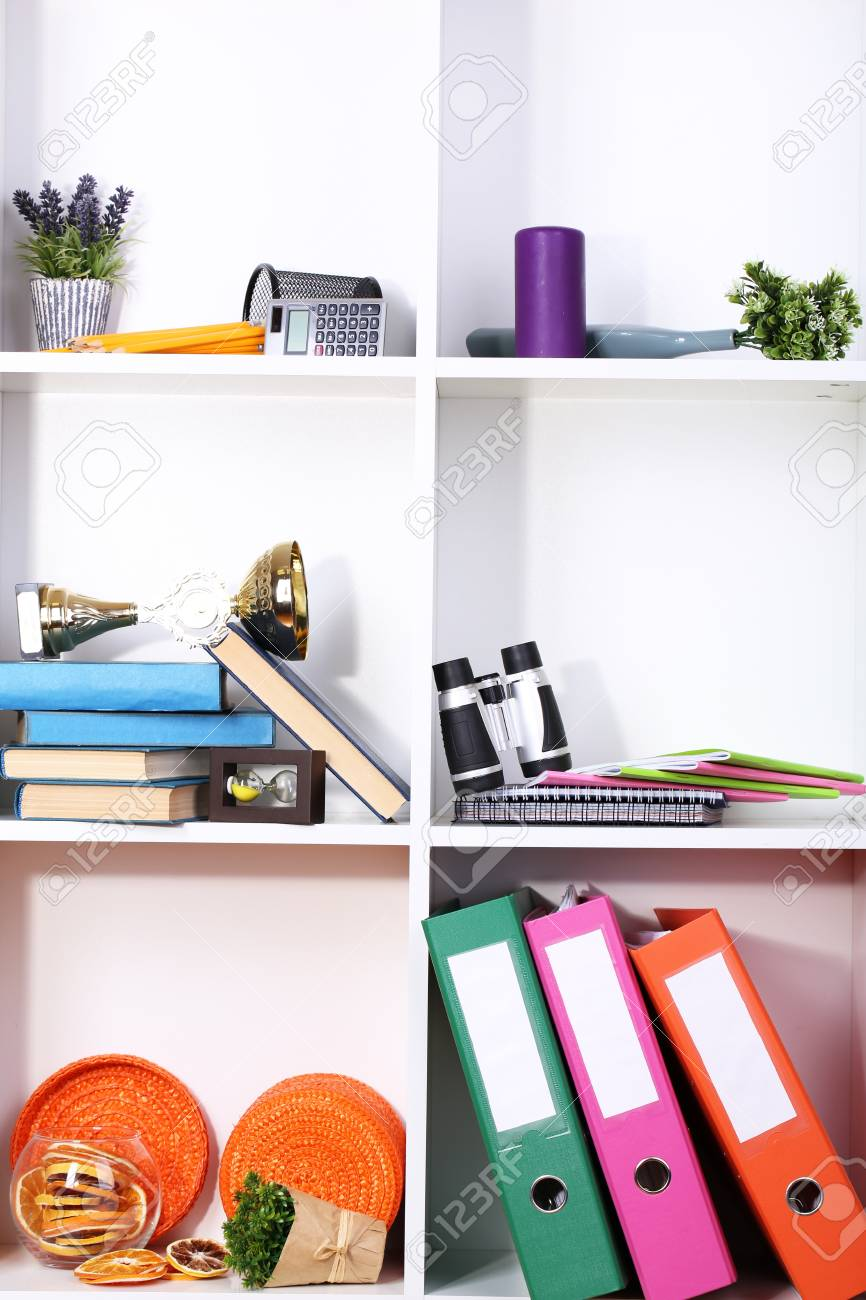 Beautiful white shelves with scattered different home related objects Stock Photo - 17400936