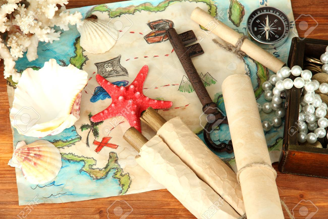 map of treasures on wooden background Stock Photo - 17404094