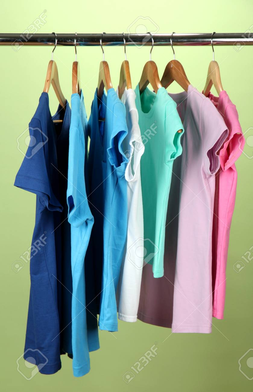 Variety of casual shirts on wooden hangers,on blue background Stock Photo - 17403720