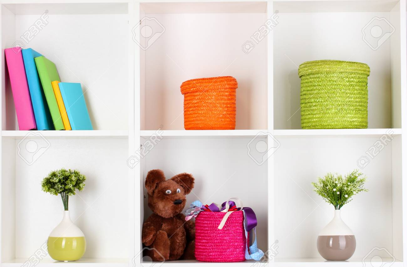 Color wicker boxes on cabinet shelves Stock Photo - 17459446