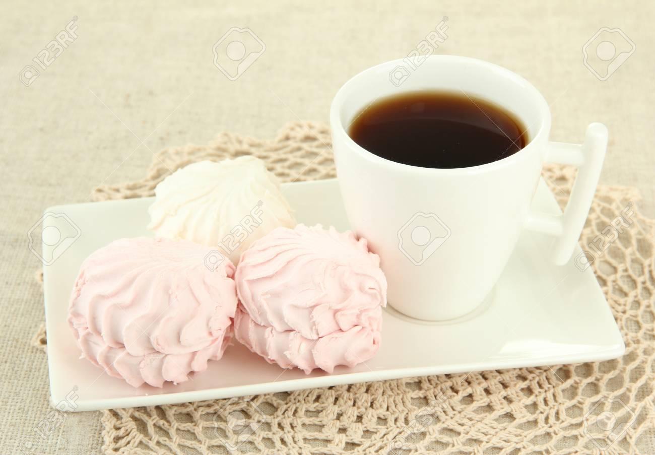 Marshmallows on plate on light background Stock Photo - 17459412
