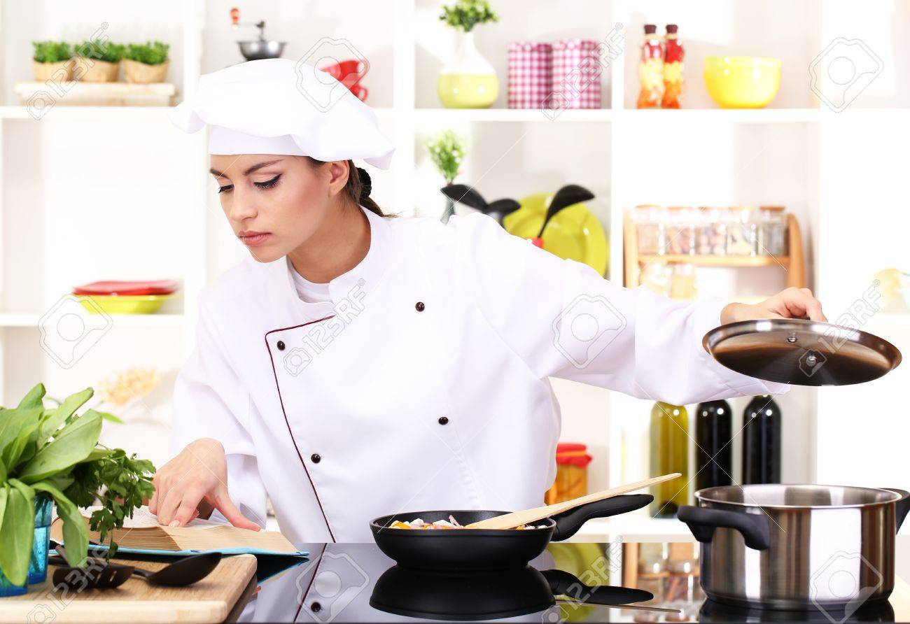 Young Woman Chef Cooking In Kitchen Stock Photo, Picture And Royalty ...