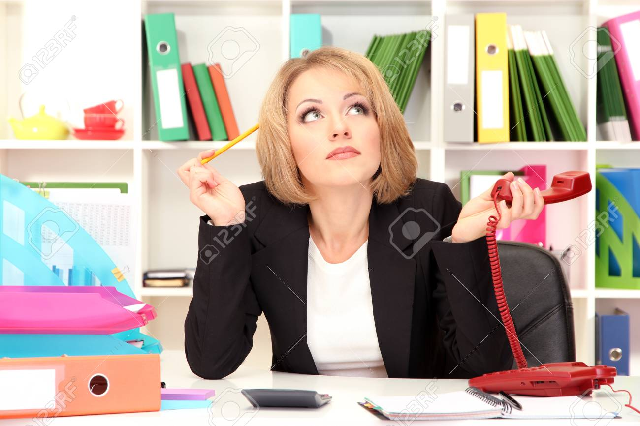 Beautiful young business woman working in office Stock Photo - 21537725