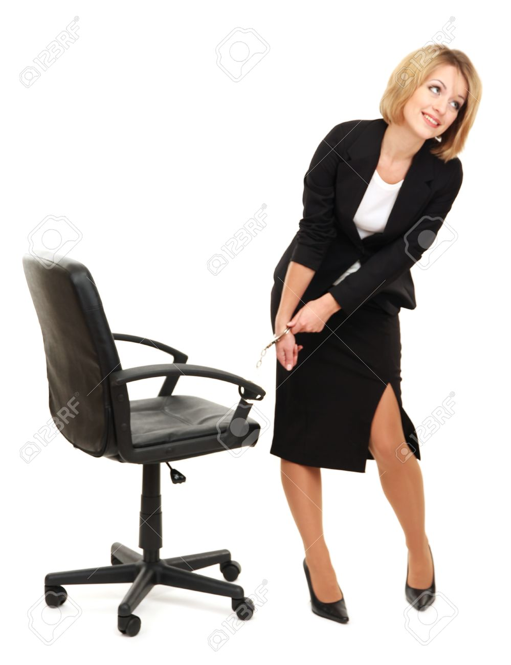 Young beautiful business woman strapped to chair with handcuffs isolated on white Stock Photo - 17485264