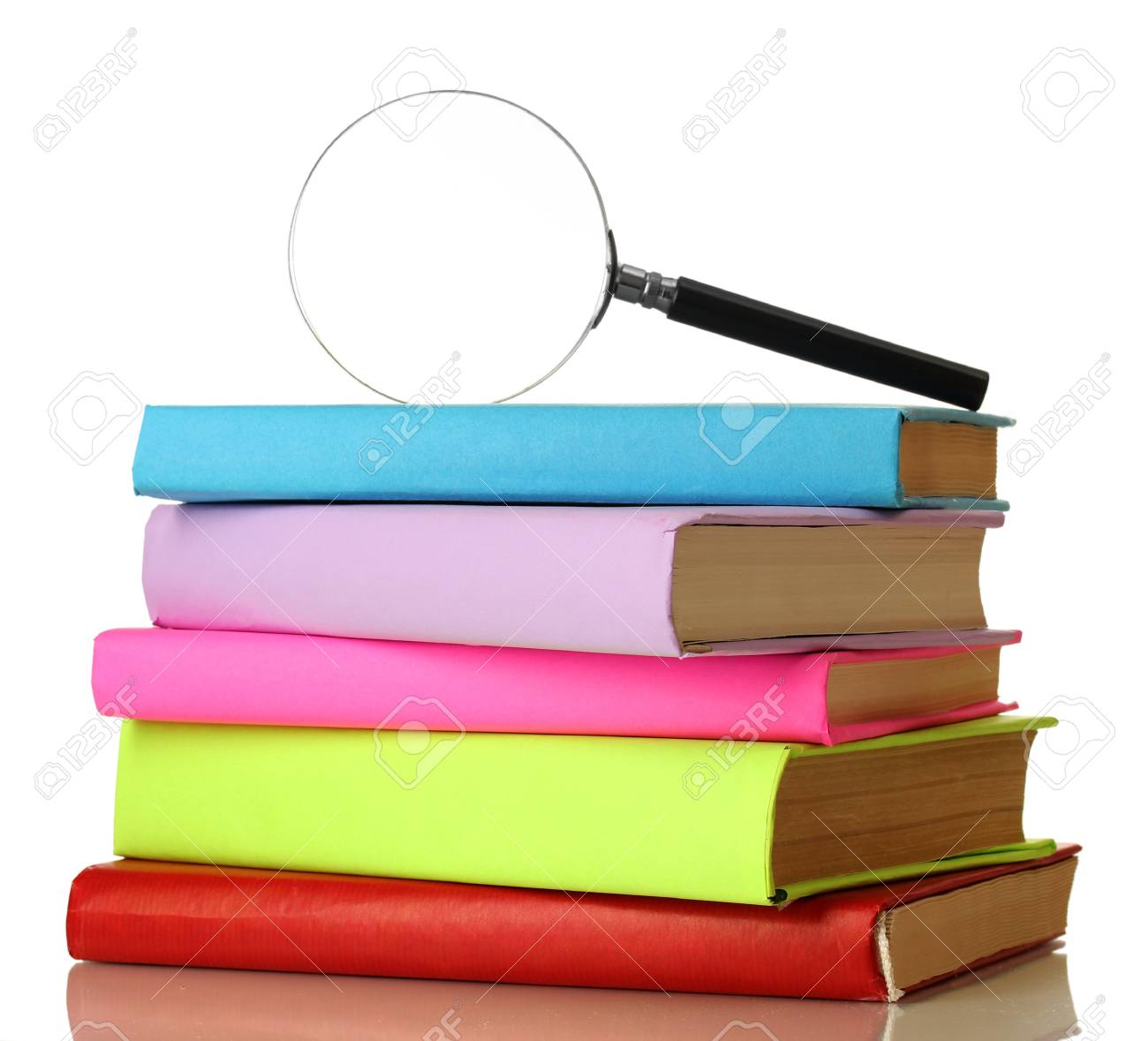 Magnifying glass and books isolated on white Stock Photo - 17514929