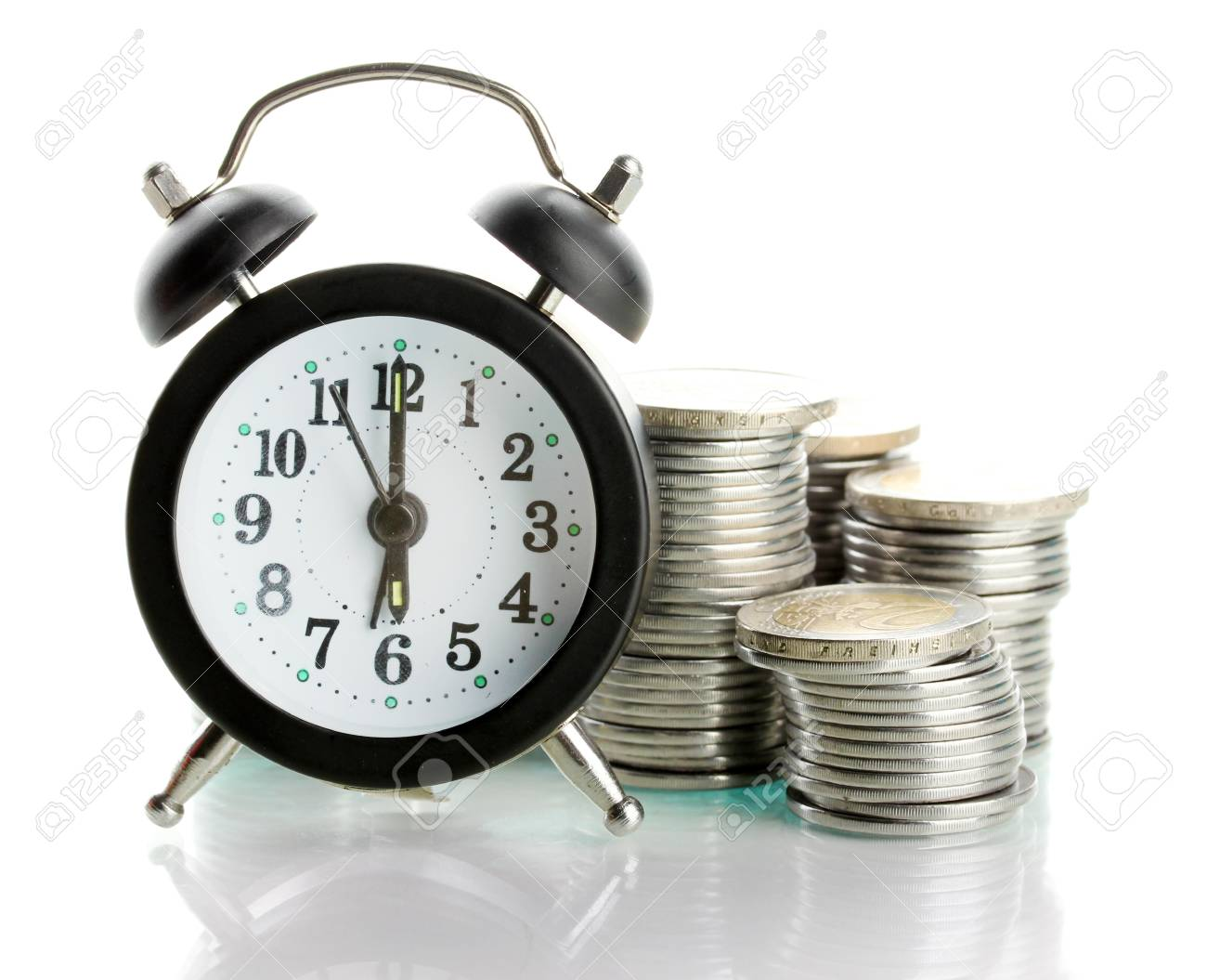Alarm clock with coins isolated on white Stock Photo - 17548023
