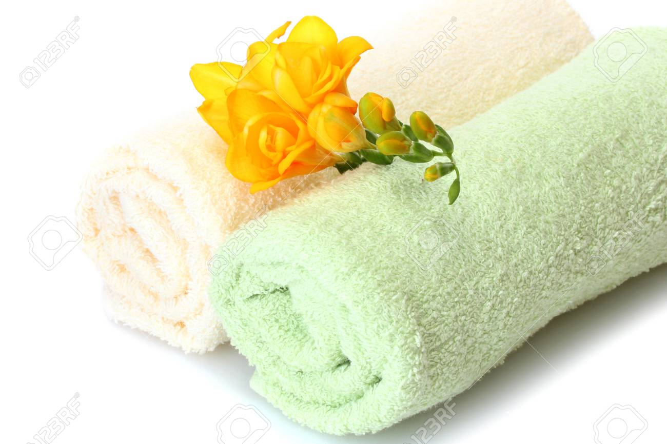 colorful towels and flowers isolated on white Stock Photo - 17644238