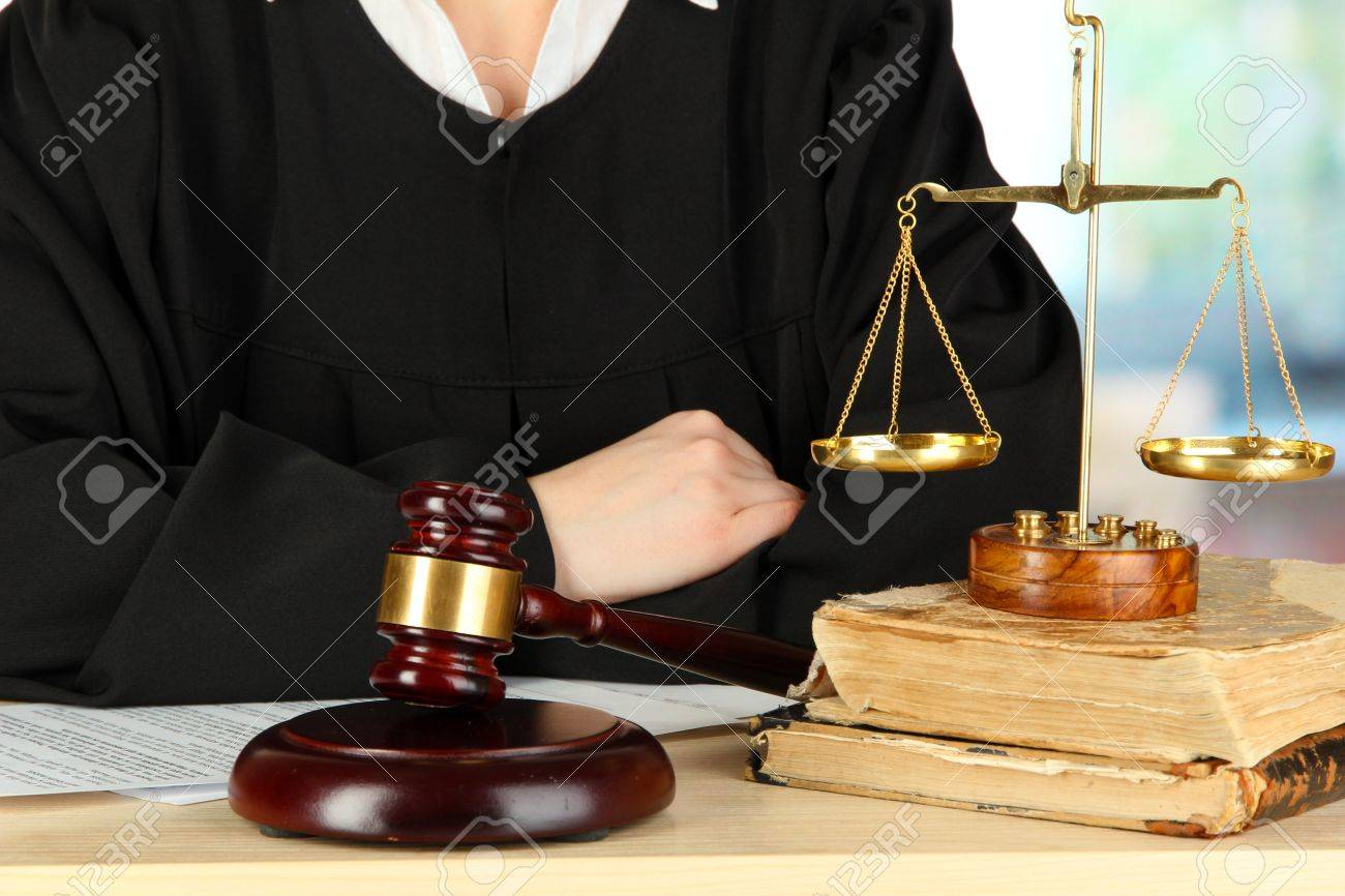 Judge sitting at table during court hearings on room background Stock Photo - 17633593