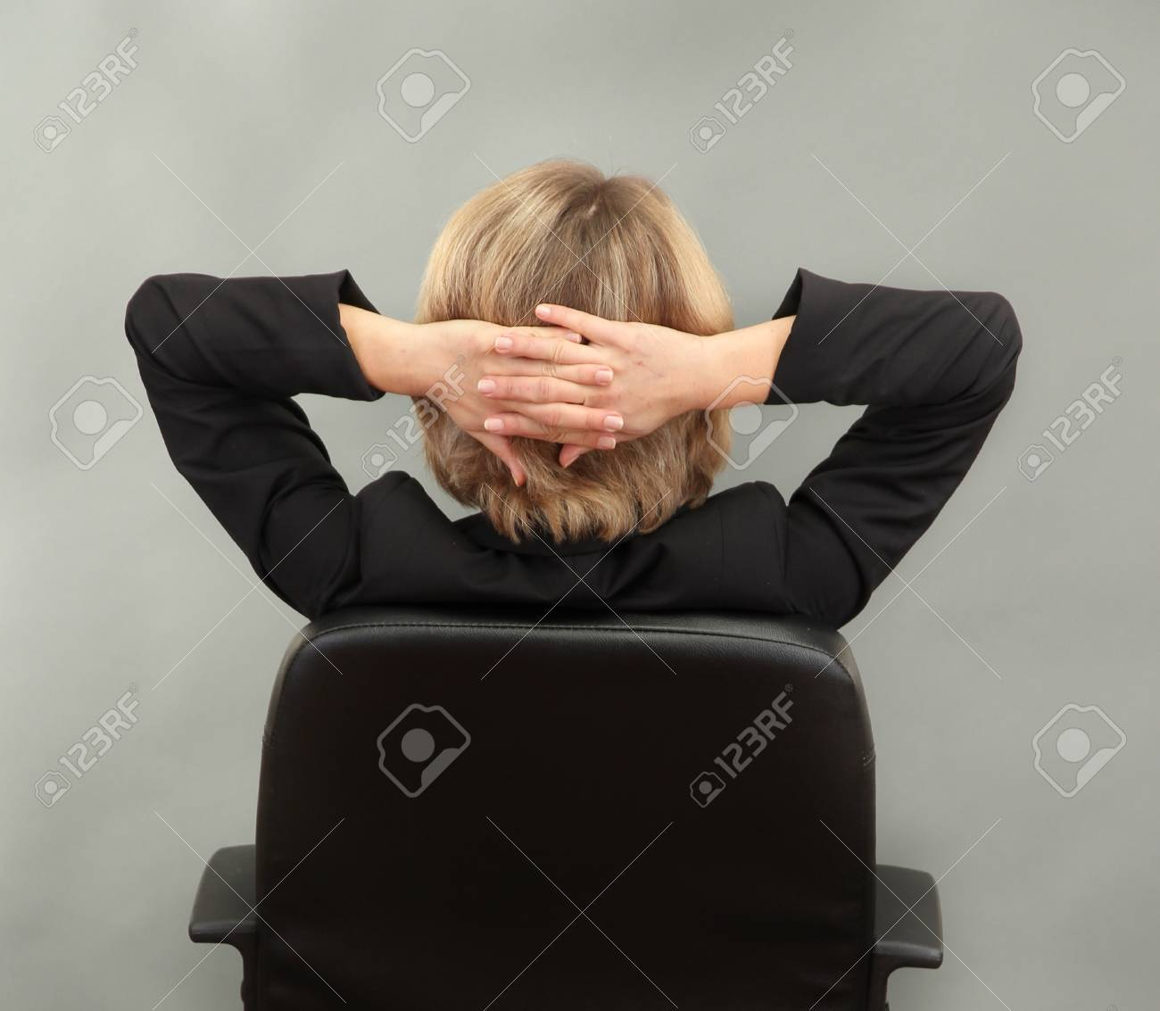 Young beautiful business woman resting on chair on grey background Stock Photo - 17633684