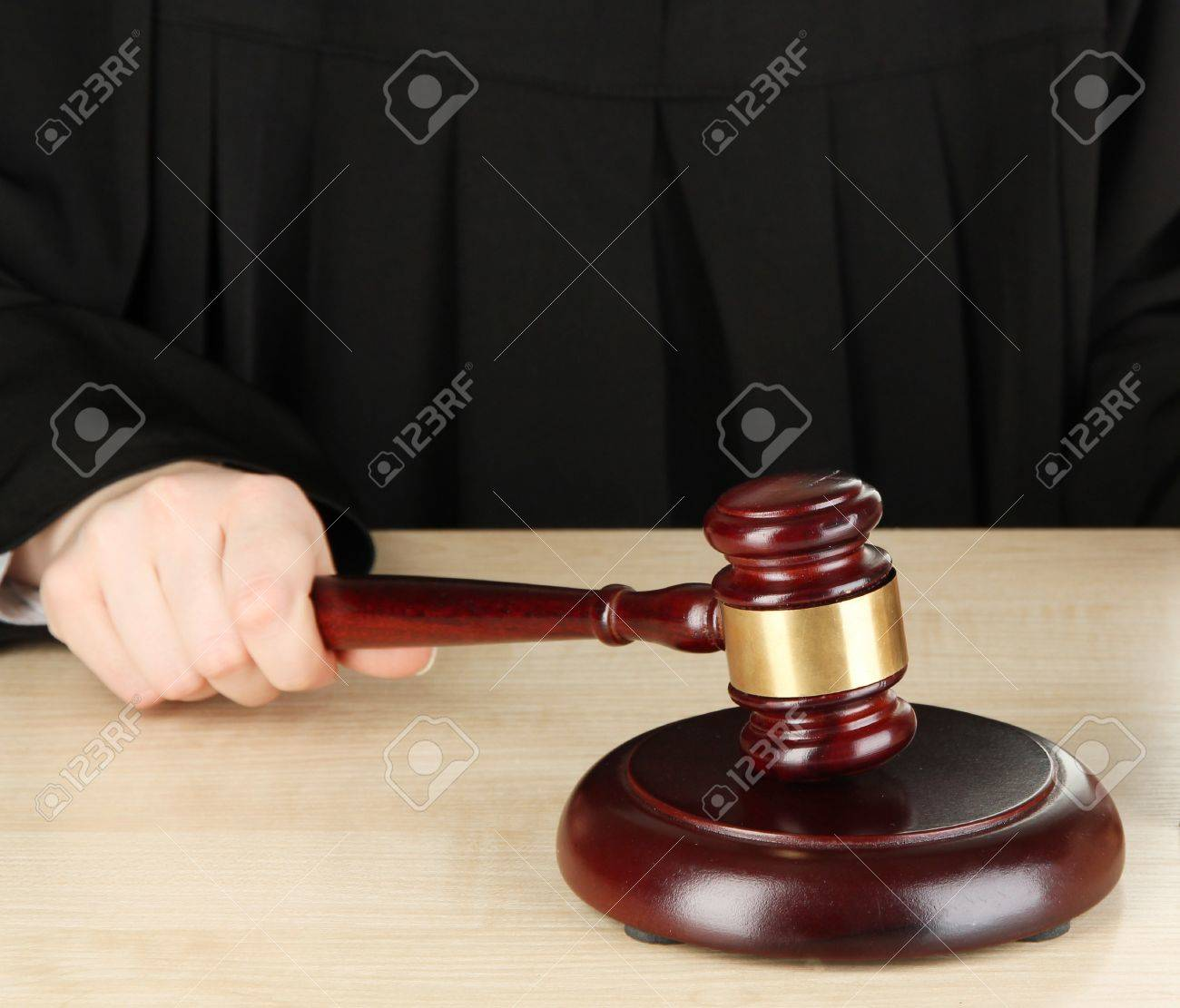 Judge sitting at table during court hearings isolated on white Stock Photo - 17633749