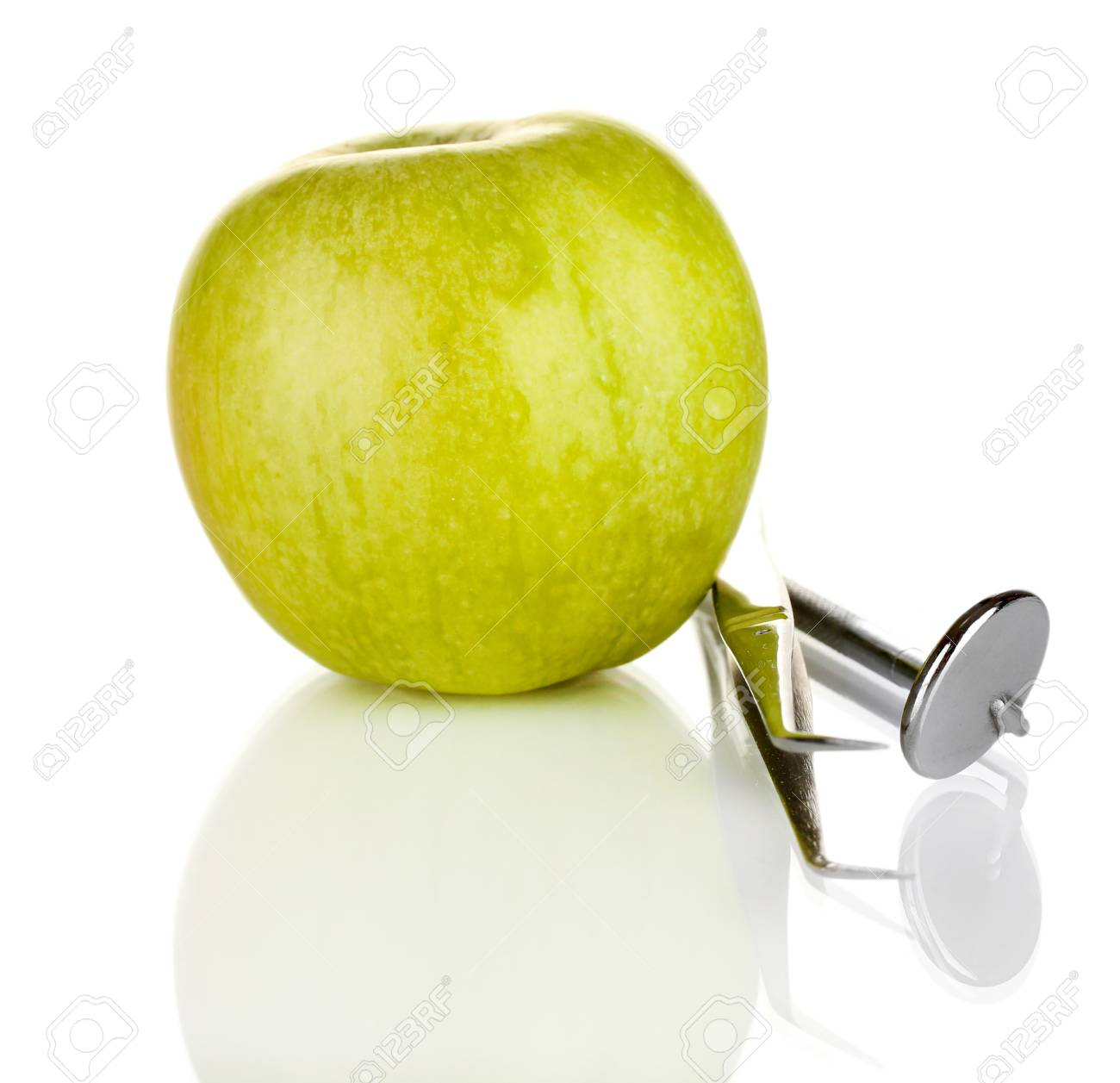 Green apple and dental tools isolated on white Stock Photo - 17648924
