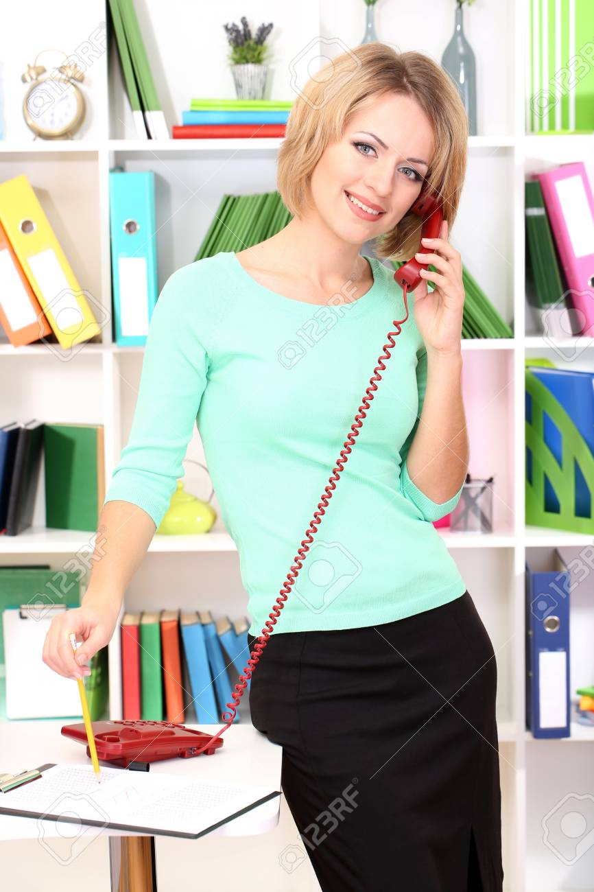 Beautiful young business woman working in office Stock Photo - 21538637