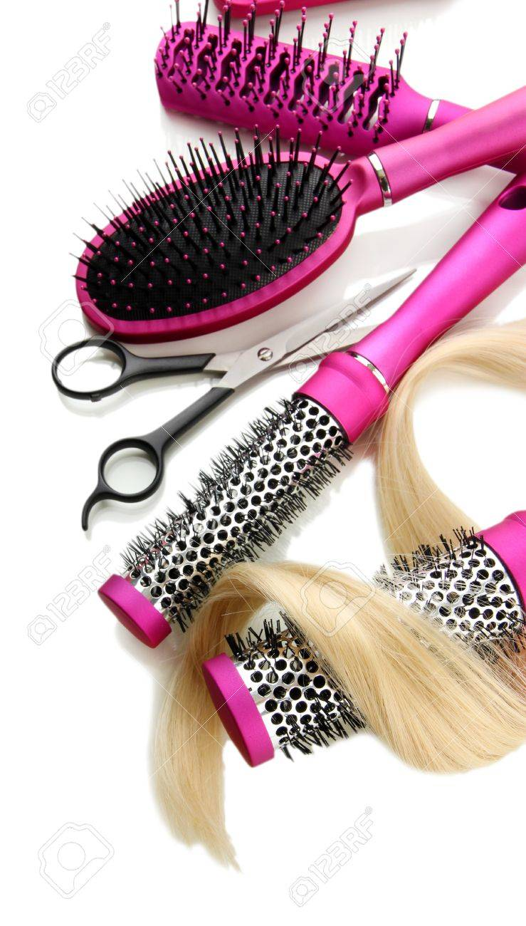 Comb brushes, hair and cutting shears, isolated on white Stock Photo - 17727538