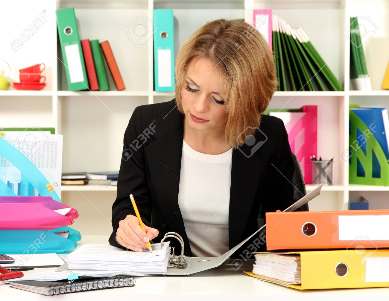 Beautiful young business woman working in office Stock Photo - 21538677