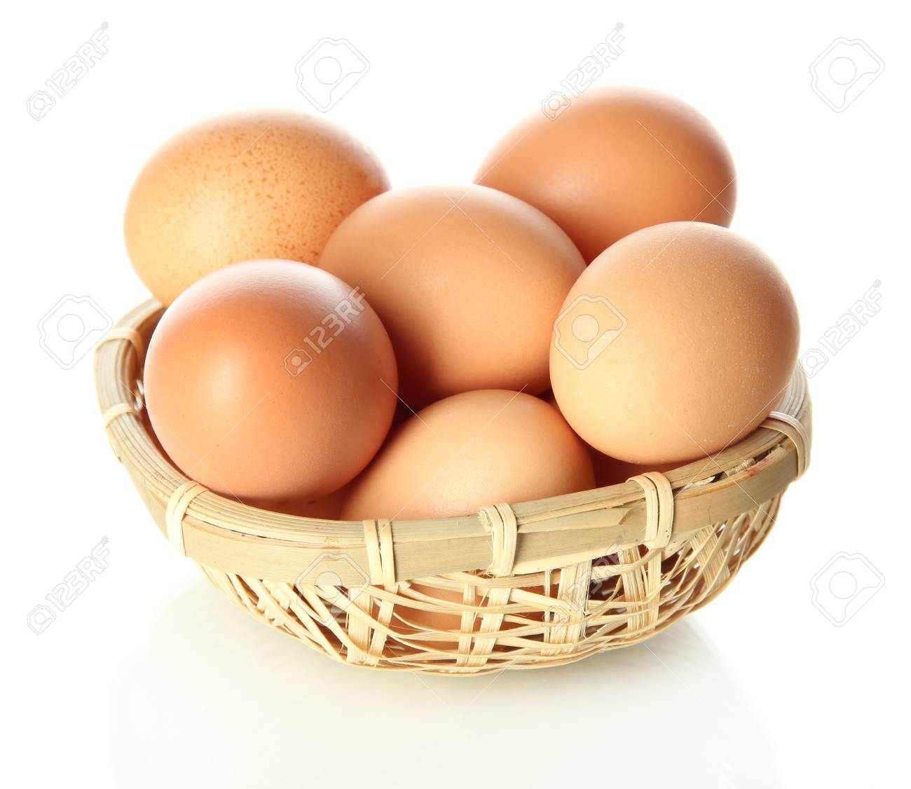 Many eggs in basket isolated on white Stock Photo - 17760875