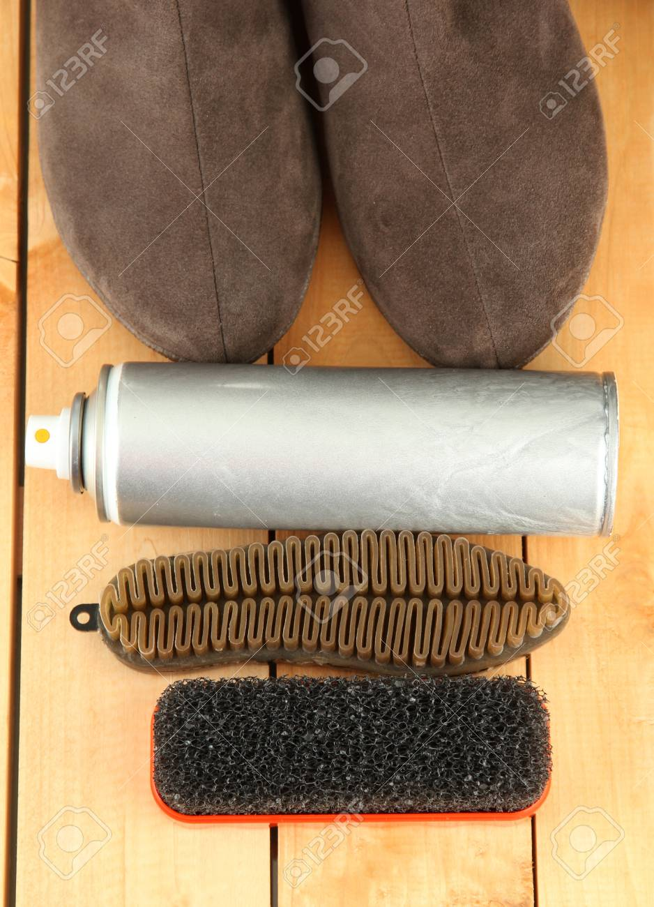 Set of stuff for cleaning and polish shoes, on wooden background Stock Photo - 17761030
