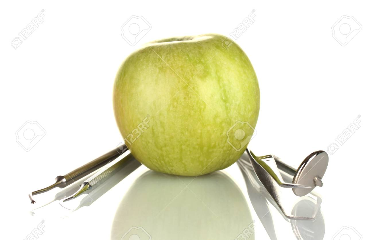 Green apple and dental tools isolated on white Stock Photo - 17769910