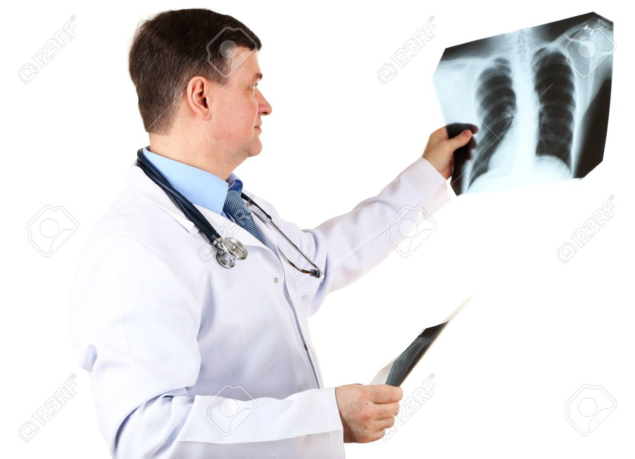 Medical doctor analysing x-ray image  isolated on white Stock Photo - 21541859