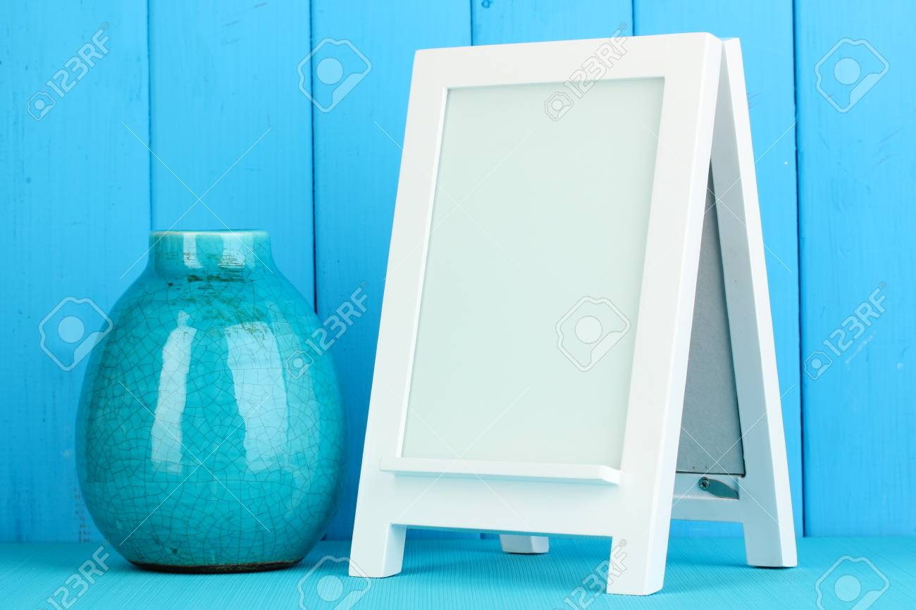 White photo frame for home decoration on blue background Stock Photo - 18217187