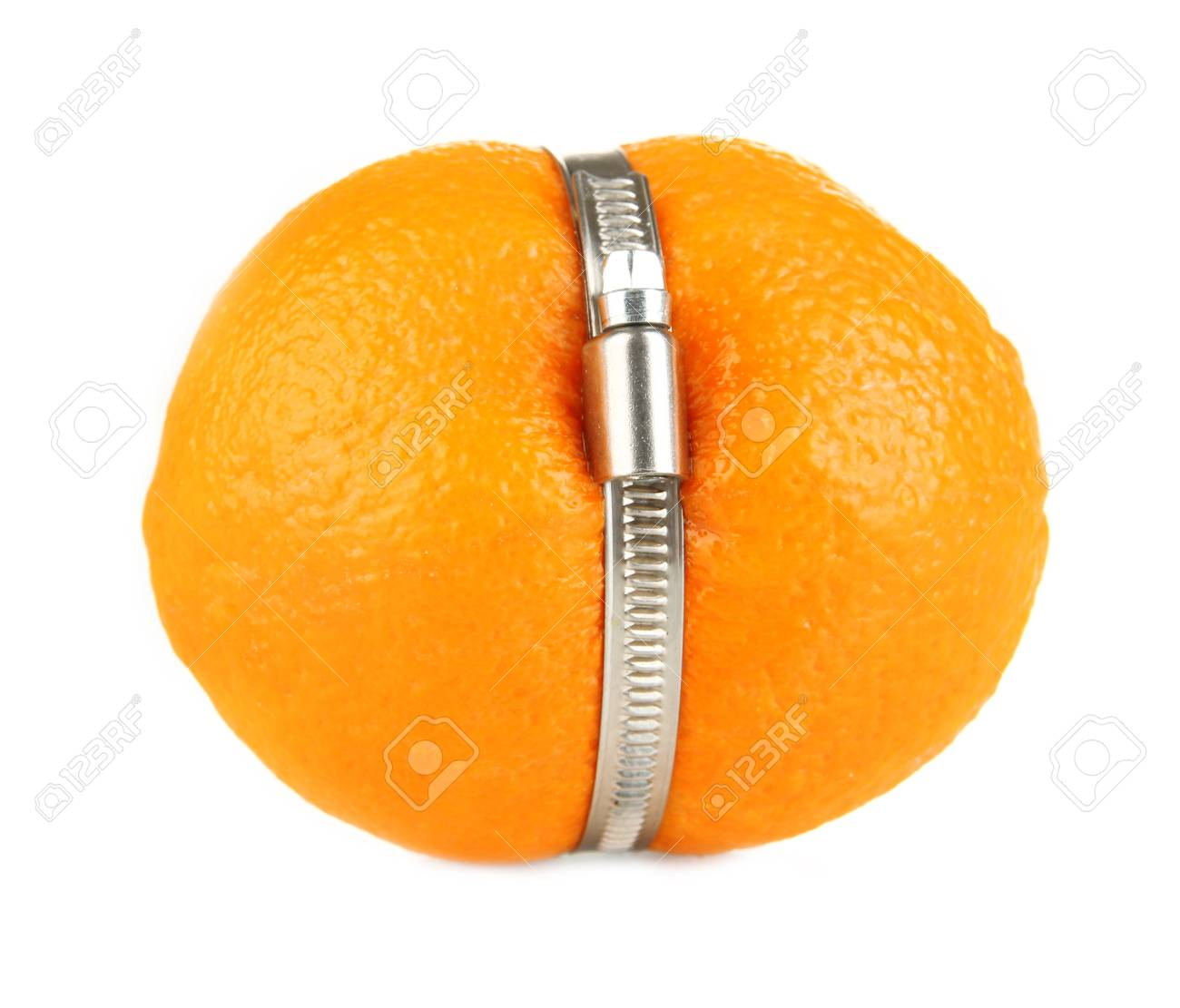Lemon squeezed in metal clamp, isolated on white Stock Photo - 18474525