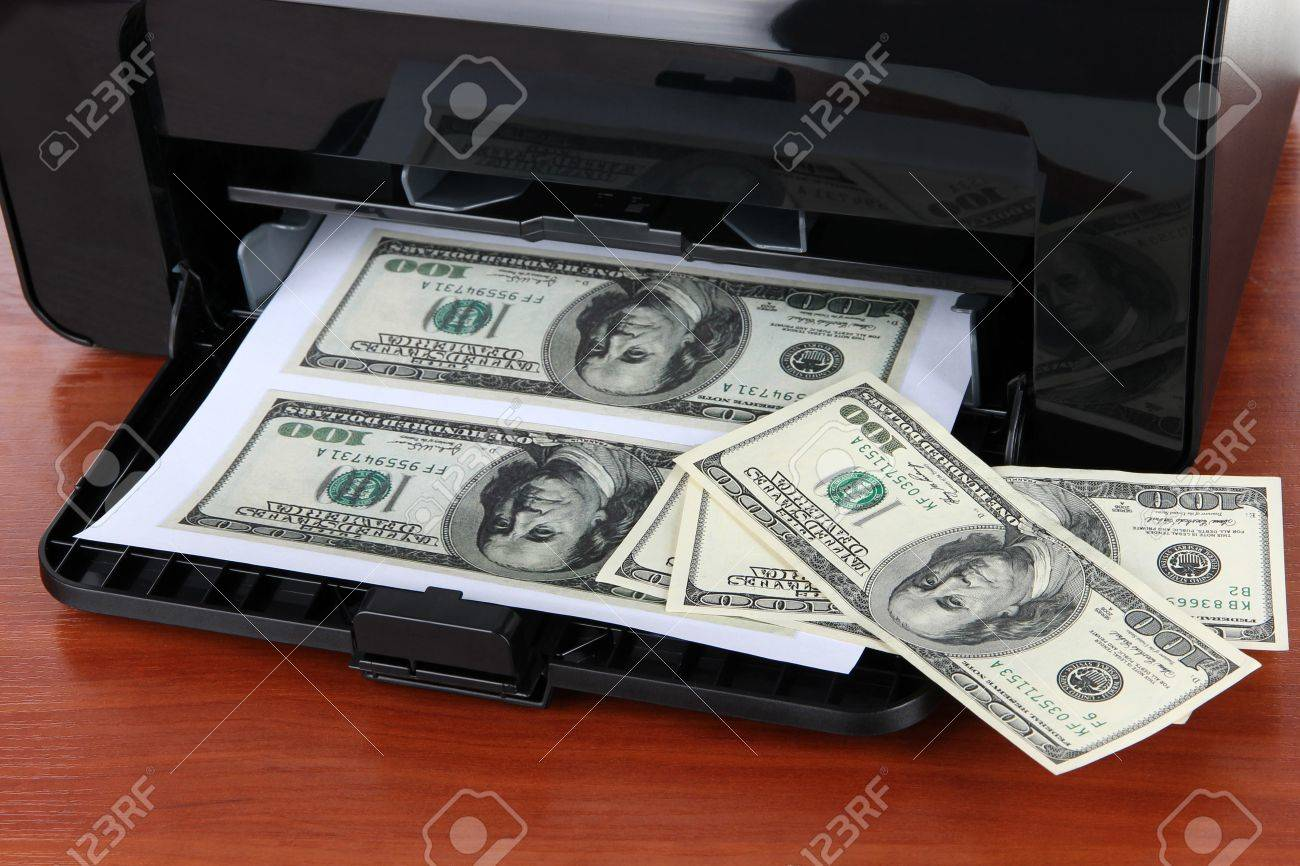 Printer printing fake dollar bills on wooden background Stock Photo - 18491052