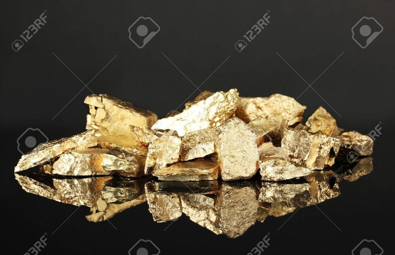Golden nuggets on dark background Stock Photo - 18490137