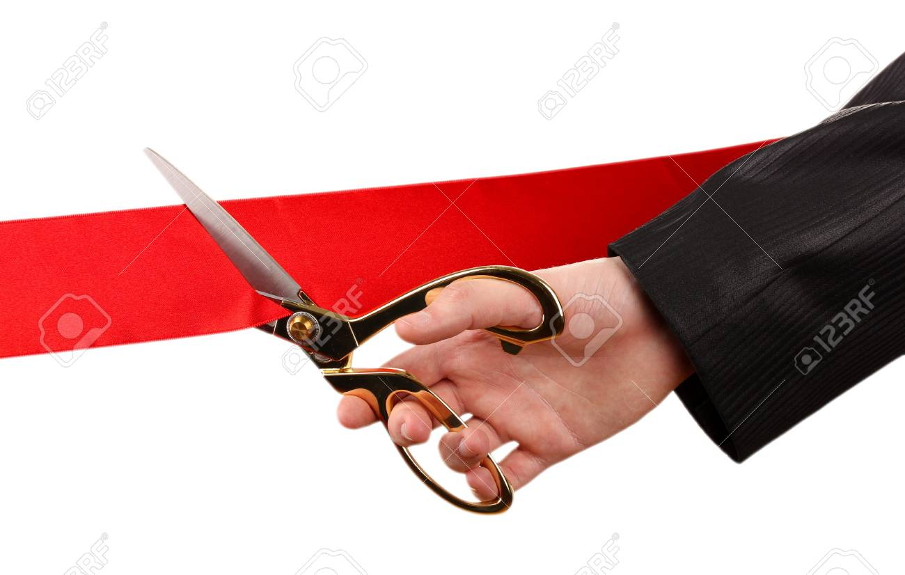 Cutting red ribbon, isolated on white Stock Photo - 18508115