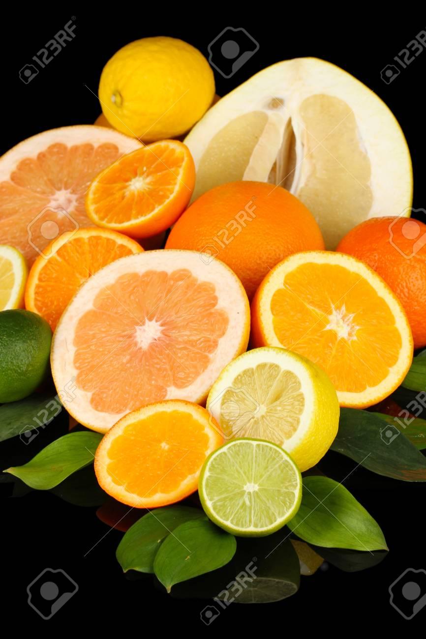 Lots ripe citrus isolated on black Stock Photo - 18557902
