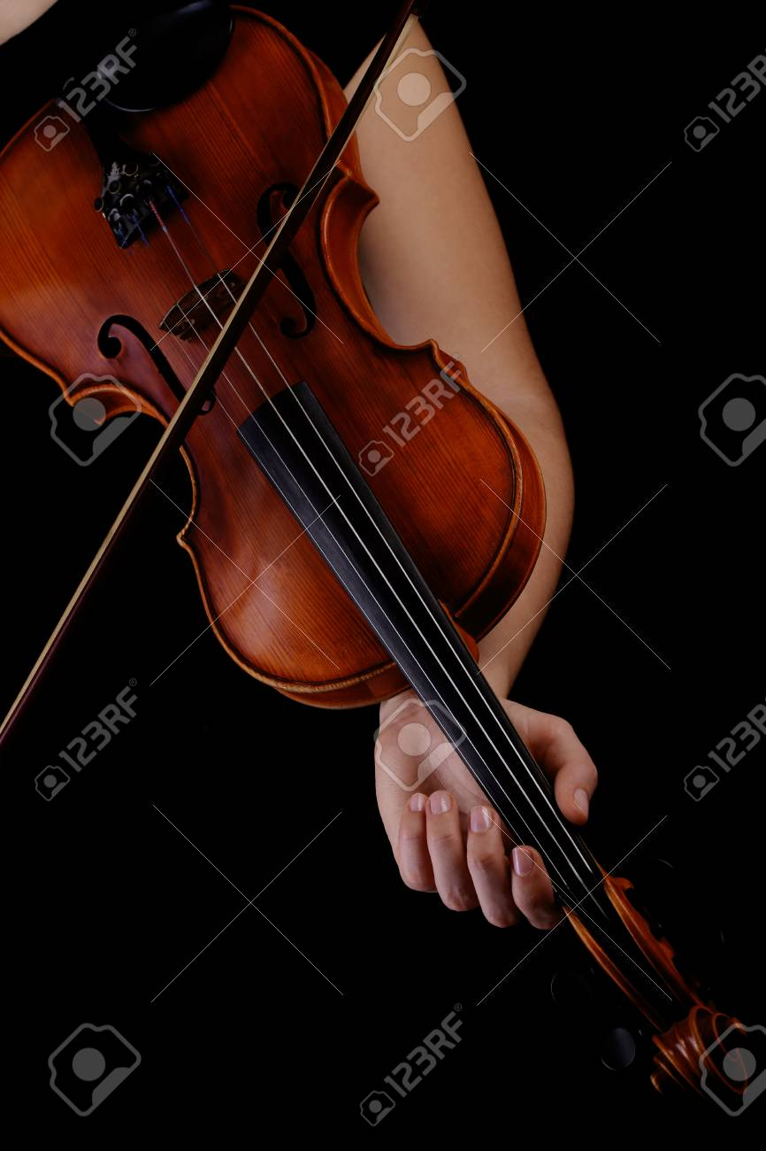 Musician playing violin on black background Stock Photo - 18818661